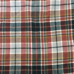 A tartan fabric in shades of red and grey