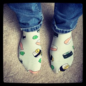 homemade sushi socks: green socks with comic style sushi printed on