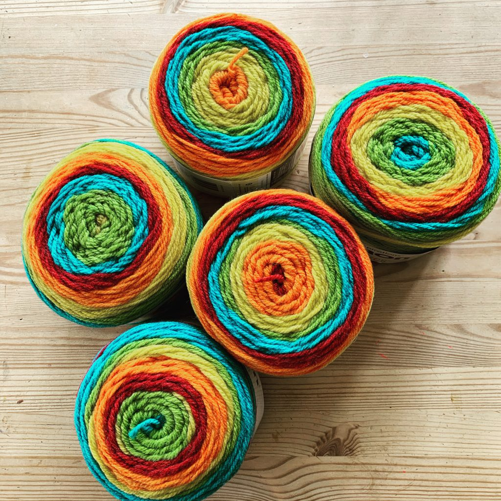 five giant balls of yarn in rainbow colours ready for Rosie's lockdown blanket