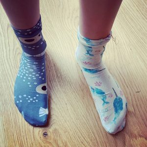 a pair of odd socks made for wellbeing Wednesday