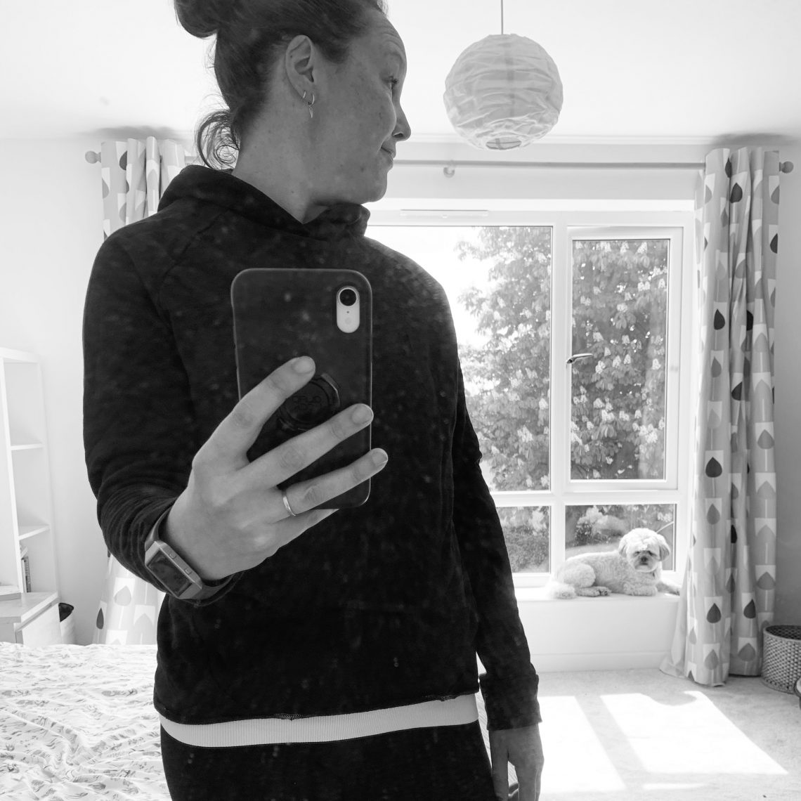 Rosie wearing a black hoody and gym clothes