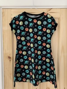 A child's dress made from black jersey with colourful planets