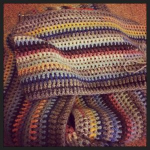 A striped crochet blanket where each row is based on the colour of the sky each day.