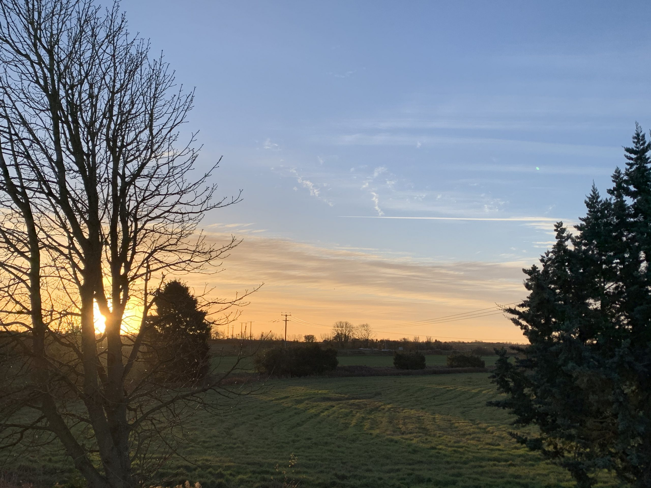 A view over fields at sunrise - inspiration for Rosie's Sky Blanket 2021