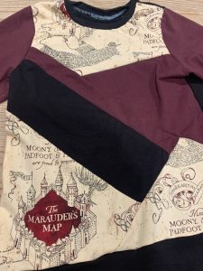 scrap busting sewing: Rosie has made a long sleeved t-shirt using scraps of Harry Potter and coordinating fabrics.