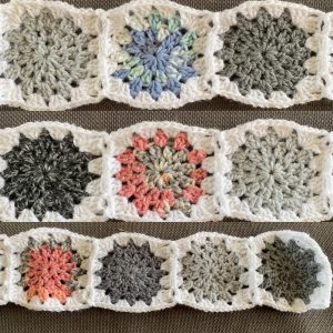 Granny squares in shades of grey, pink and blue to represent the sky during January
