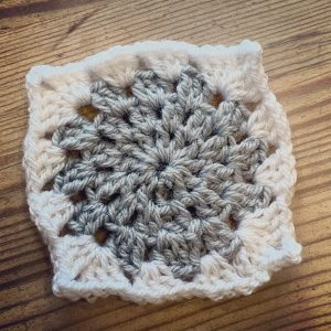 A grey granny square to start January in blanket form